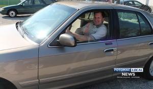 A Runner Up, Winner Accepts Raffled Car