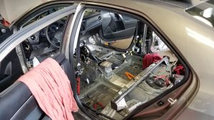 Removing the vehicle interior to replace airbag wiring harness.jpg